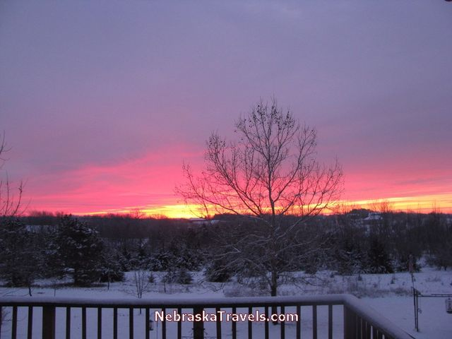 Beginning of Colorful Red and Blue Nebraska Midwest Country Sunrise sky - 7-34am