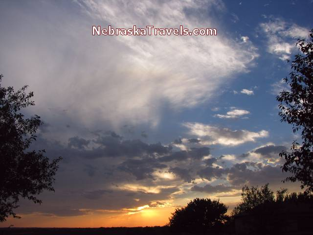 Sunset Photo with pink and yellow Colors with blue and white clouds - Eastern Nebraska Midwest country area