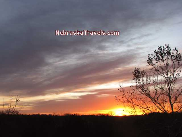 Colorful orange - red - sunrise clouds with dark blue sky - Nebraska Midwest country road - Sunrise Photo