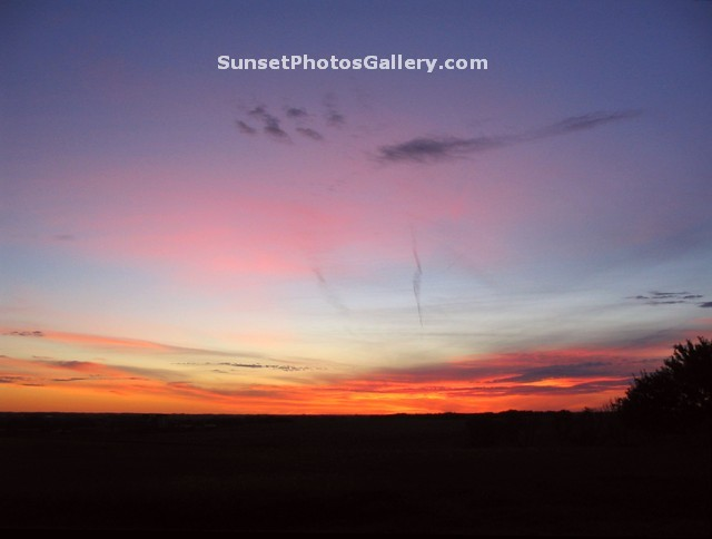 Sunset Photo with many Red - Oraange - Pink Color in cloudy dark blue sky - Midwest country area