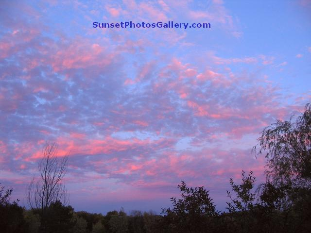 Sunset Photo with Pink Color puffy clouds in blue sky - Nebraska Midwest country area