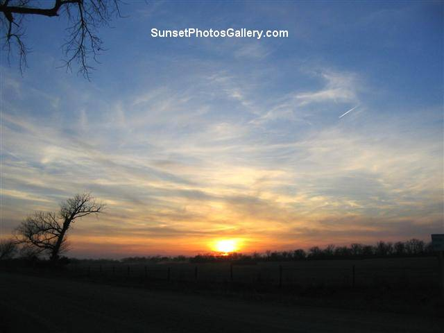 Colorful clouds - Red, orange and blue color sky - Beautiful Rural Sunset + one jet trail - Sunset Photos Gallery