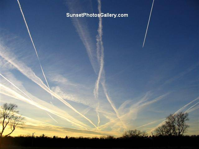 "Nebraska Sunset Photos Gallery - Colorful blue sky with MANY jet trails - some ""moving"""