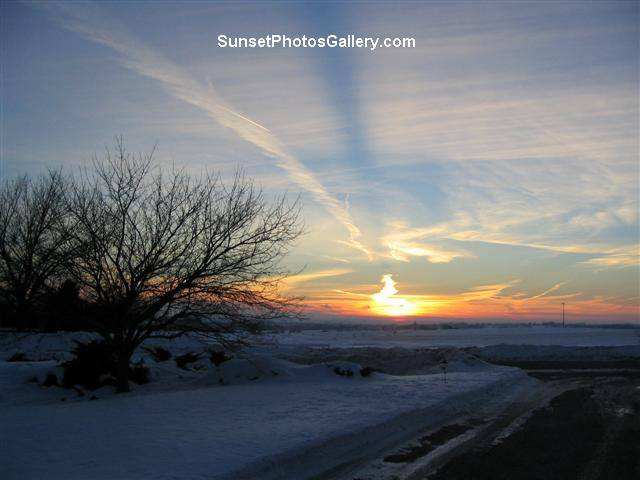 "Nebraska Midwest Colorful Sunset and clouds - red, orange and blue color sunset with "" beam "" in sky + jet trail"