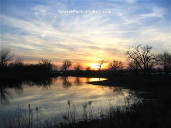 Nebraska Sunset over small lake next to Alda Sandhills Crane Viewing area on the Platte River