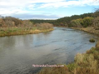 Niobrara River from walking bridge with Smith Falls Park campgrounds and picnic areas